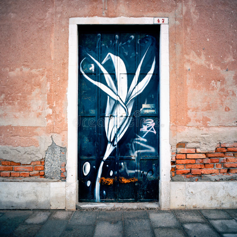 Italy. Venice Flower painted door royalty free stock images