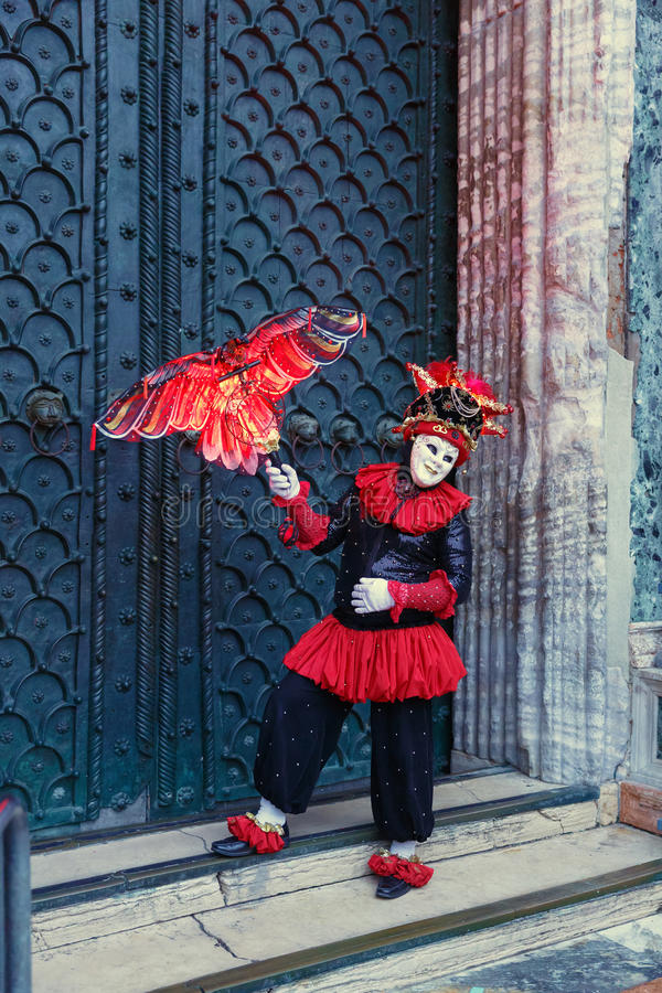 Italy; Venice, 24.02.2017. A man in a carnival costume with a de stock images