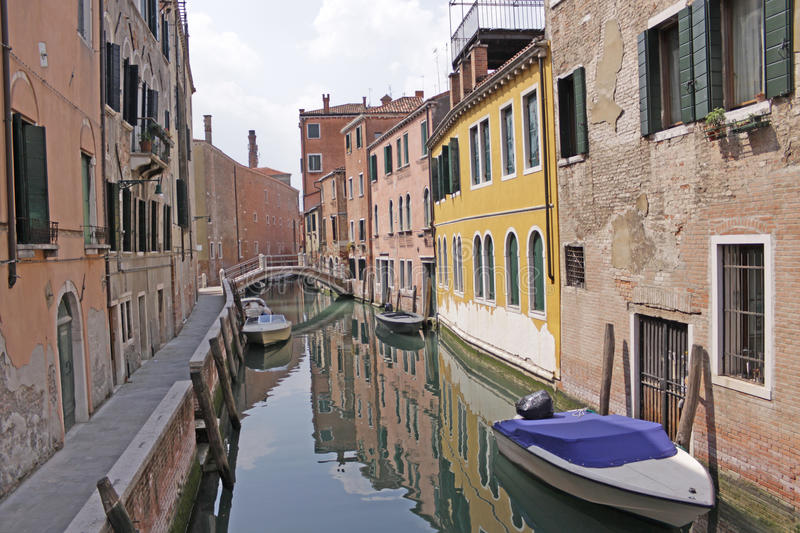 Italy. Venice. The old house and the bridge over the canal stock photos