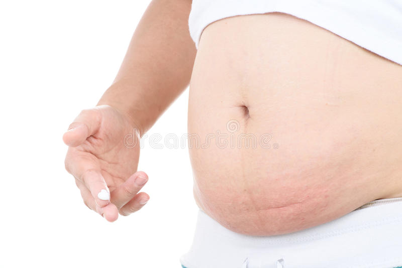 Itch and pain of pregnant belly. Woman itch and pain of pregnant belly. Isolated on white background royalty free stock images