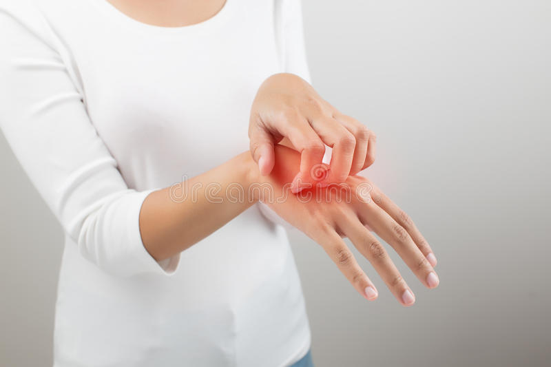 Itch. Women scratch the itch with hand, on white background stock photo