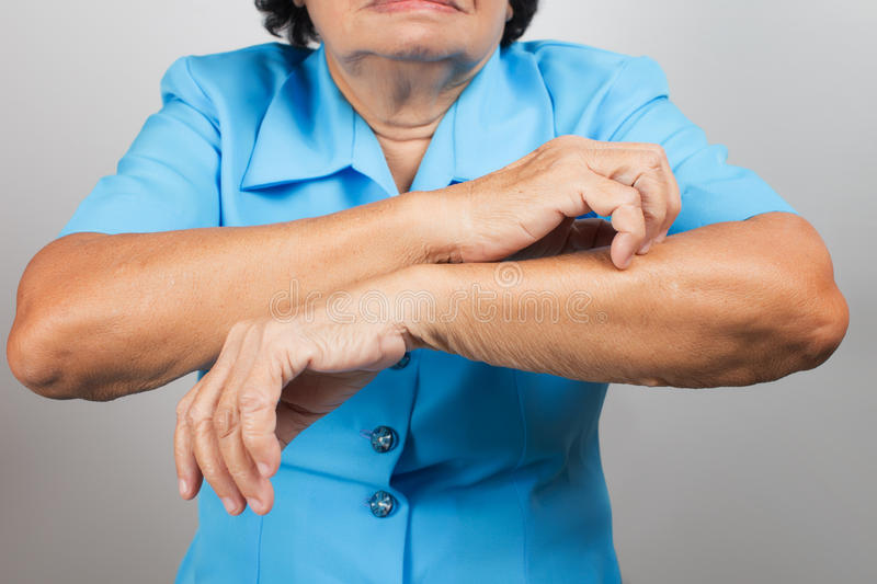 Itching In A old woman. On grey background stock photos
