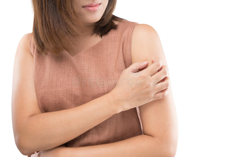 Itching. People scratch the itch with hand, Upper arm, itching, Healthcare And Medicine, Women with skin problem concept stock photography