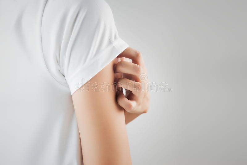 Itching. In A Woman on white background royalty free stock image