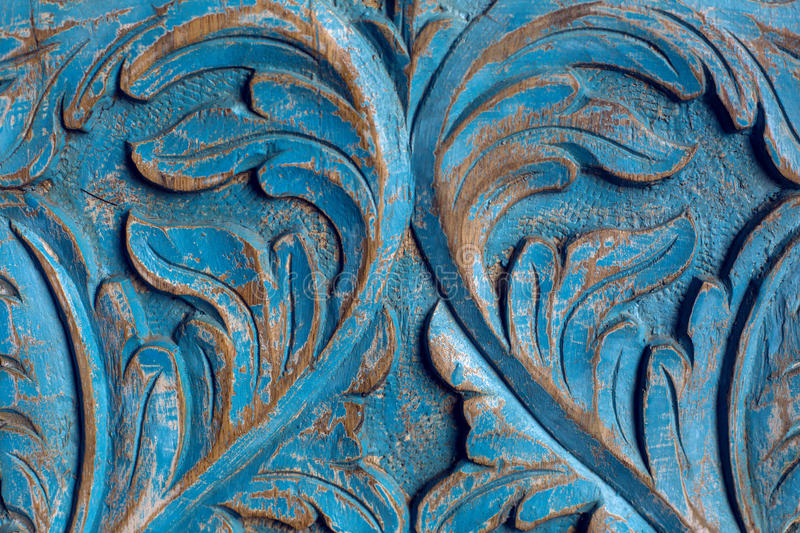 Item wooden wardrobe painted in blue paint pattern. And carving with flower and leaves royalty free stock images