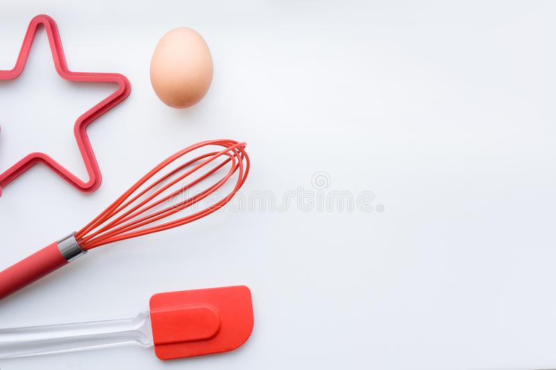Items for scrambled eggs and omelets, desserts, bakery. Egg, corolla, silicone spatula, silicone mold. The concept of stock photo