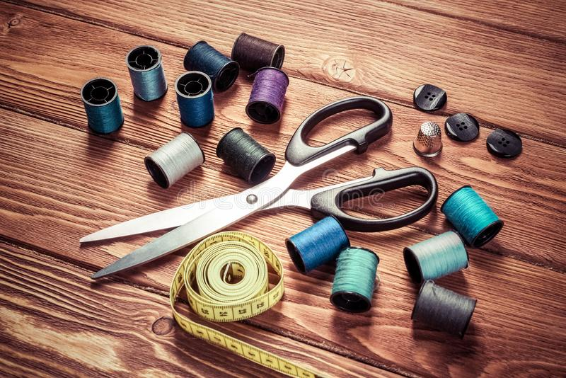 Items for sewing or DIY. Bright image of sewing kit accessories on wooden table royalty free stock images