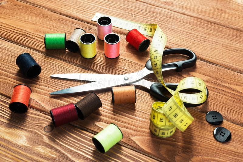 Items for sewing or DIY. Bright image of sewing kit accessories on wooden table stock photos