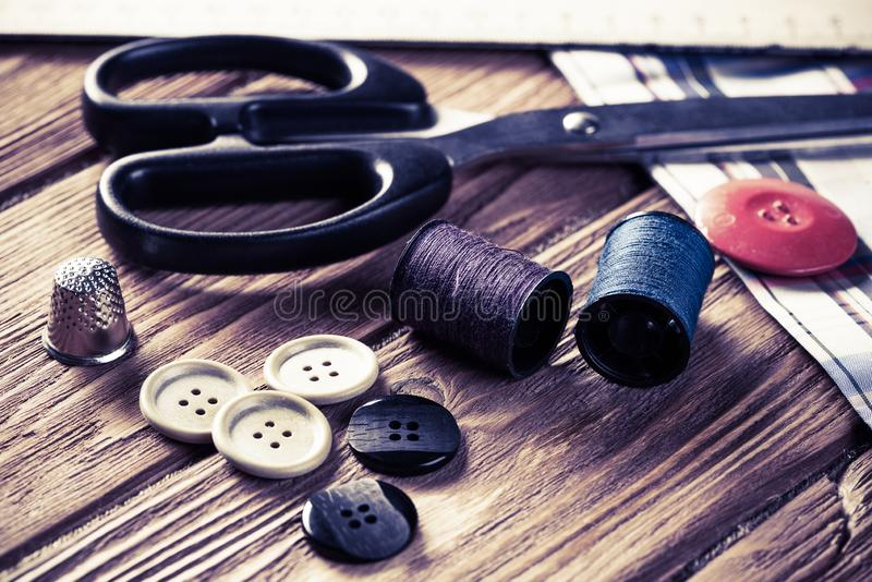 Items for sewing or DIY. Bright image of sewing kit accessories on wooden table stock images