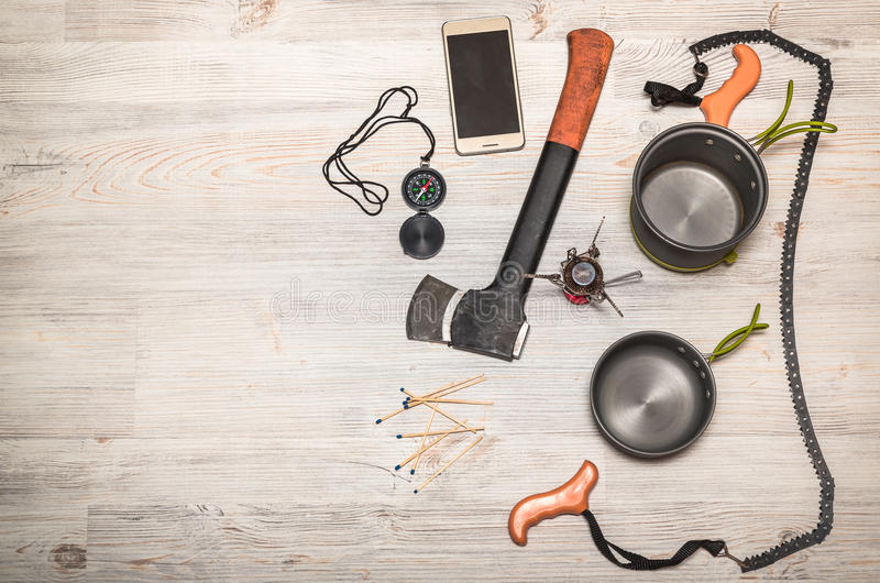 Items for travel. Set of travel accessories on wooden background royalty free stock images