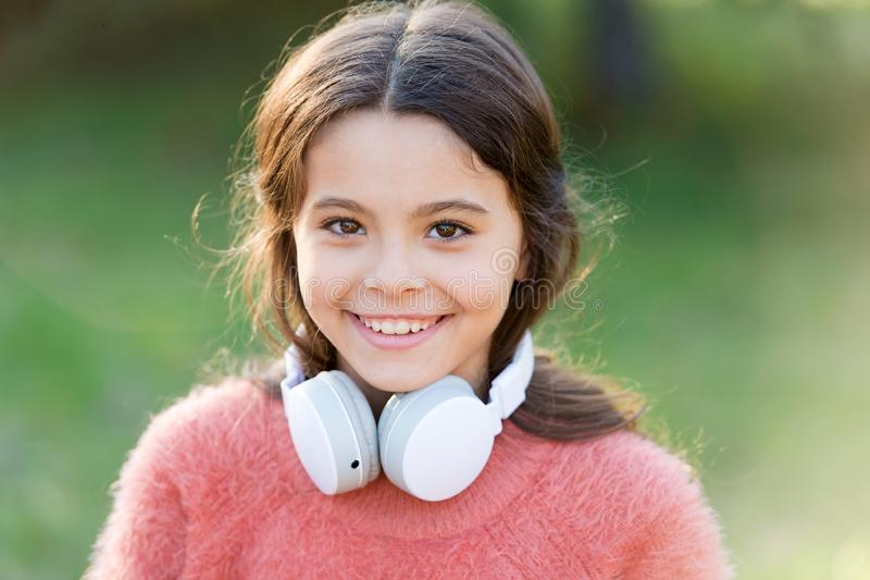 Its all about music. Little music fan on autumn day. Happy little girl in autumn. Little girl listen to music. Happy royalty free stock image