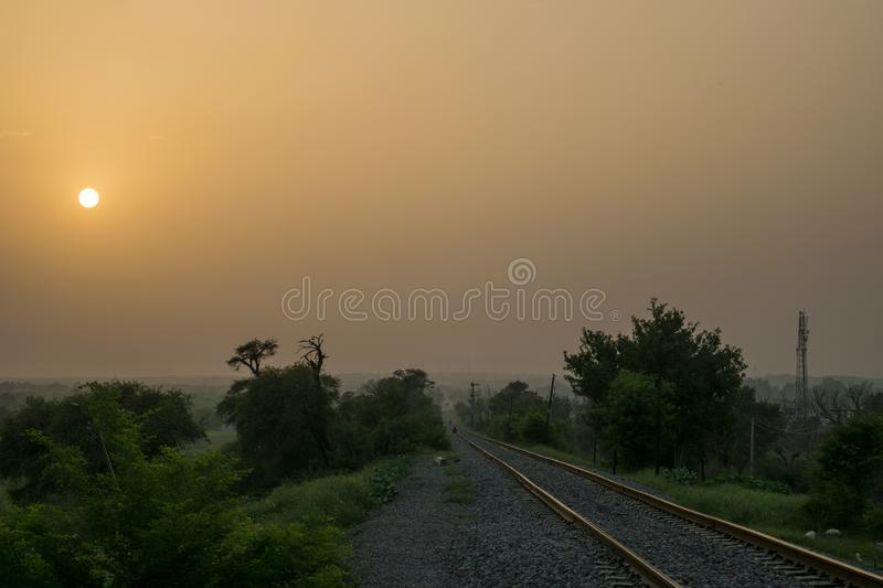 Train track going to heaven with a beautiful sunset view. Its always amazing to watch sunset but this scene is more pleasing with heaven track view royalty free stock image