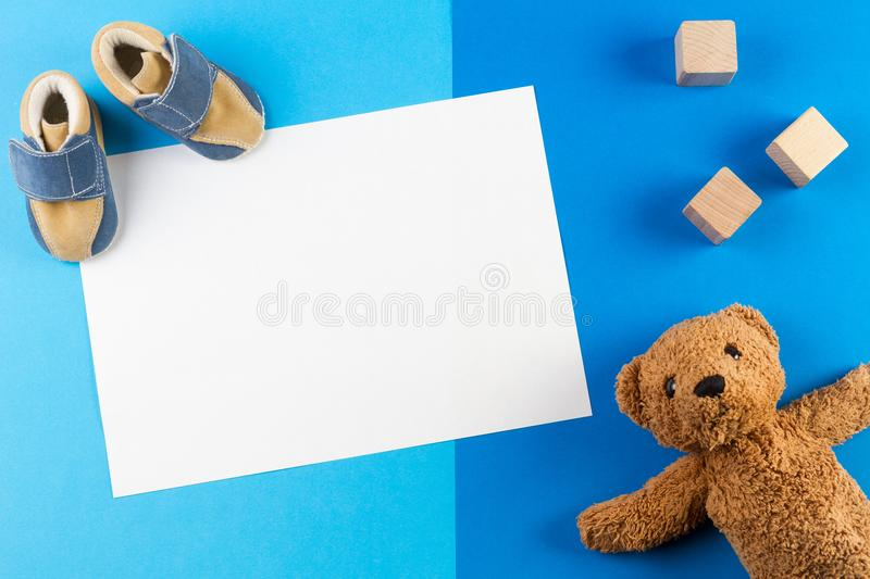 Its a boy, blue theme Baby shower or Nursery background with blank card, teddy besr, wooden blocks and baby shoes stock images