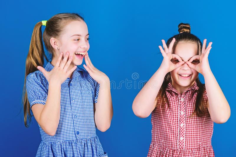 Its funny. Funny children. Funny little girls enjoy playing together. Small kids gesturing and making funny faces for royalty free stock photography