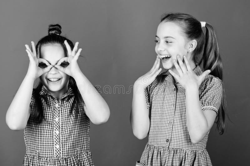 Its funny. Funny children. Funny little girls enjoy playing together. Small kids gesturing and making funny faces for stock photo