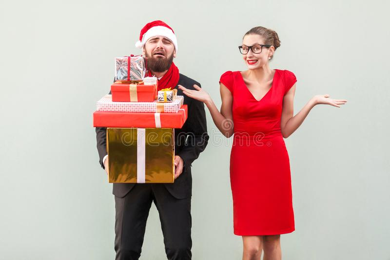 Its so hard and i tired! Not my problem, everything fine. Bearded man holding many gift box and crying, women looking stock photos