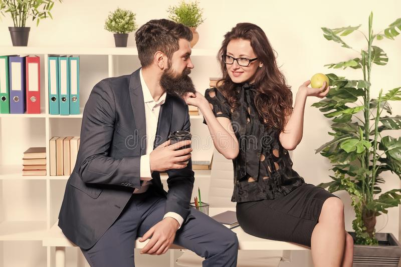 Its just a harmless flirt. Romantic couple conducting workplace affair. Boss and secretary having romantic relationship. Romantic love of bearded men and sexy stock photography