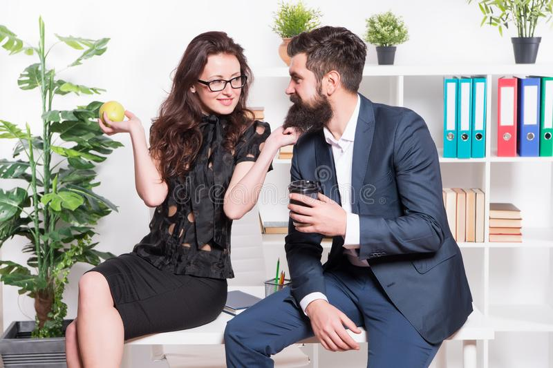 Its just a harmless flirt. Romantic couple conducting workplace affair. Boss and secretary having romantic relationship. Romantic love of bearded men and sexy royalty free stock image
