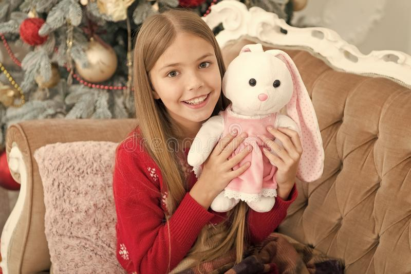 Its so lovable. Little child play with soft toy. Small child happy smiling with present. Best Christmas toy. Little girl stock photos