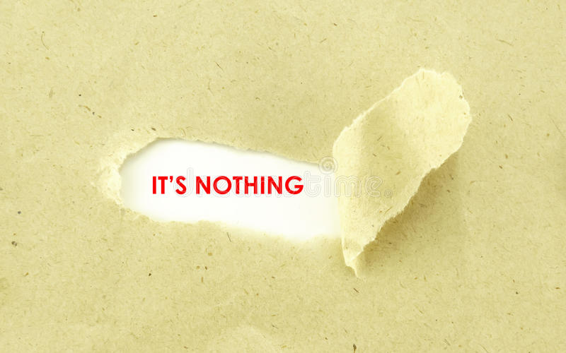 ITS NOTHING. Text ITS NOTHING appearing behind torn light brown envelope royalty free stock photography