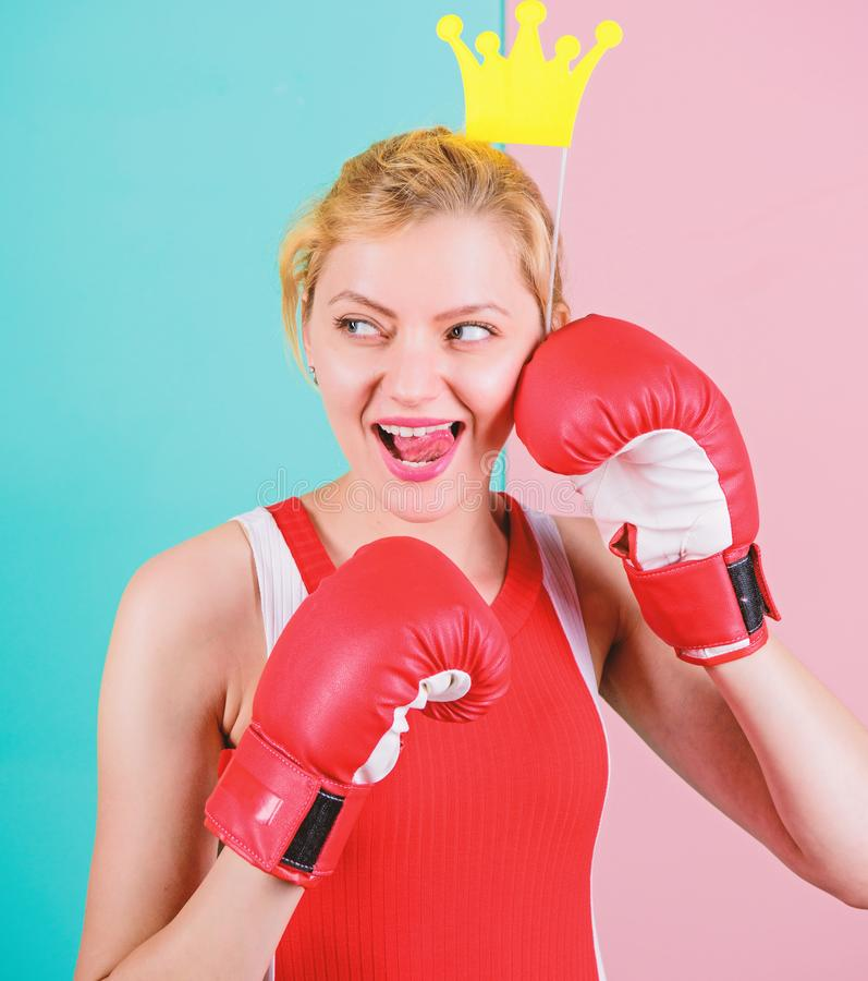 Its party time. Sportswoman with princess look. Funny woman with crown prop in boxing gloves. Cute boxer girl with party stock photo