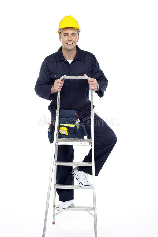 Download Its Work Time. Repairman Climbing Stepladder Stock Image - Image: 26567215