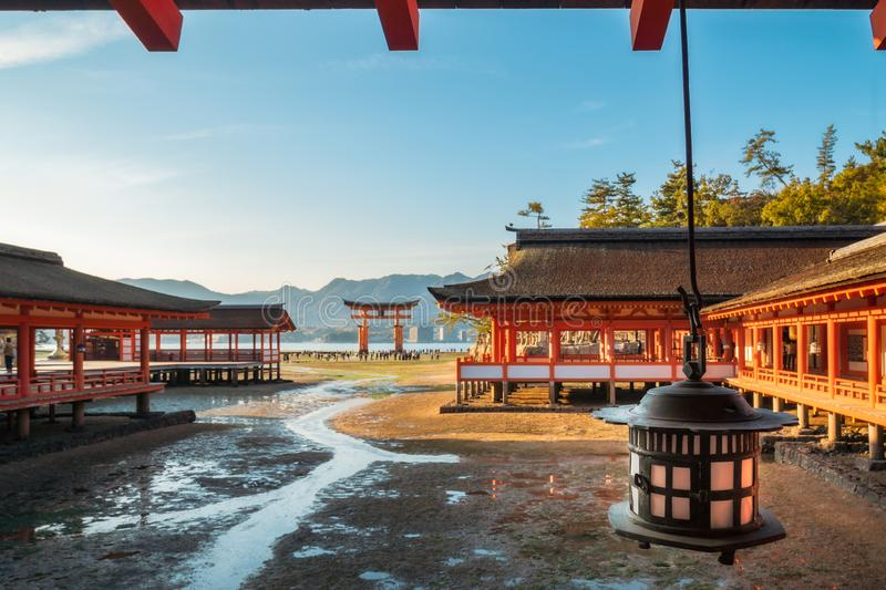 Itsukushima Shinto shrine and it`s famous Torii Gate on Miyajima Island in Japan. The Shinden architectural style complex is built on stilts by the sea, so the royalty free stock photo