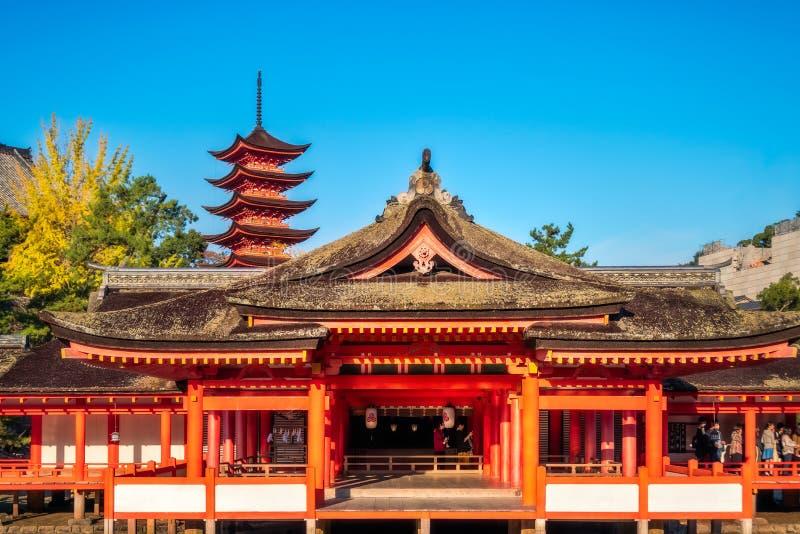 Itsukushima Shrine main shrine and Pagoda at Miyajima island, Japan. Miyajima Island, Hiroshima, Japan -November 7, 2018: Itsukushima Shrine main shrine and the royalty free stock photo