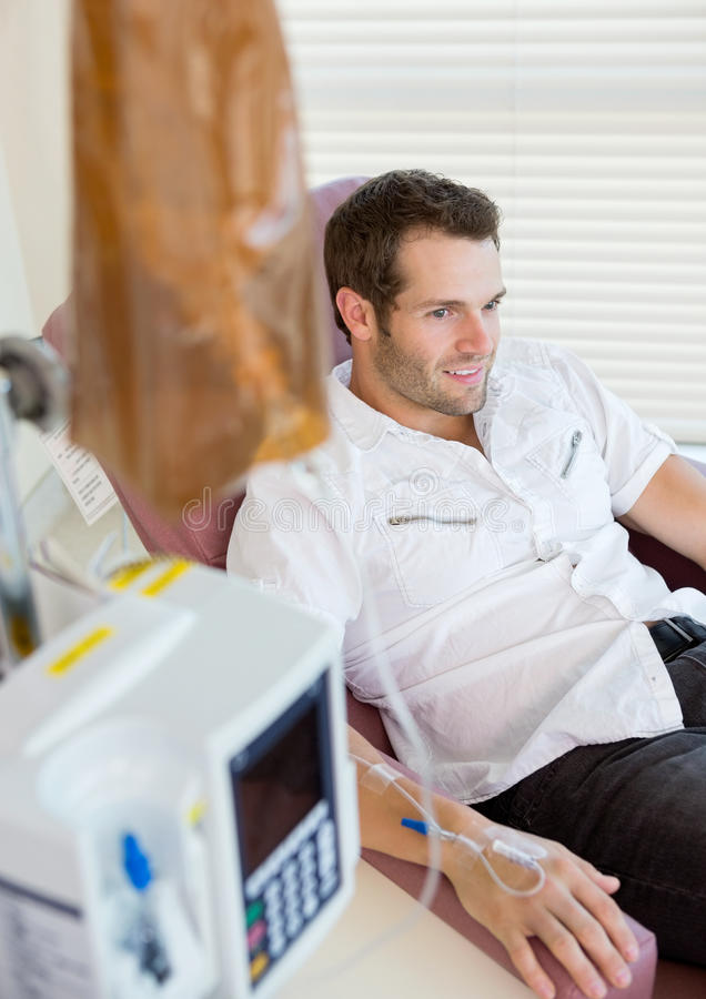 IV Drip Attached To Patient's Hand stock photography