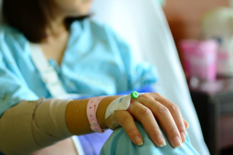 IV solution intravenous drip patient hand stock photo