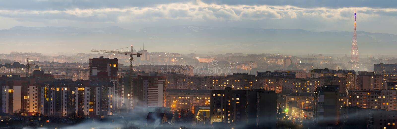 Ivano-Frankivsk市,乌克兰夜鸟瞰图全景  现代夜城市场面有高楼明亮的光的  r 图库摄影