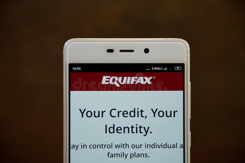 Equifax logo seen on the smartphone screen royalty free stock photos