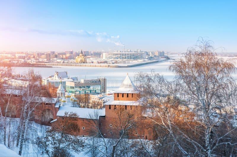 Ivanovskaya Tower and the Alexander Nevsky Cathedral. Ivanovskaya Tower of the Nizhny Novgorod Kremlin, view of the frozen Volga and the Alexander Nevsky royalty free stock image