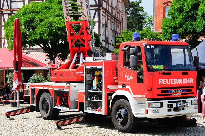 Iveco Magirus rotating ladder from german fire department Peine f. PEINE / GERMANY - JUNE 22, 2019: Iveco Magirus rotating ladder from german fire department stock photos