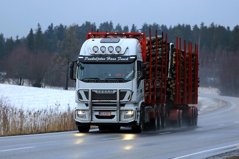 Iveco Stralis Logging Truck Transport in the Blue Hour stock image