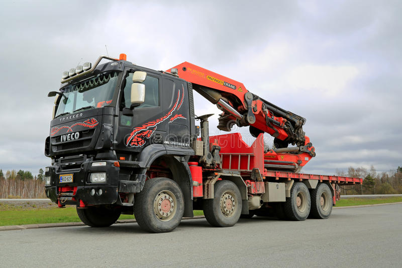 Iveco Trakker With Truck Mounted Palfinger Crane. FORSSA, FINLAND - MAY 5, 2014: Iveco Trakker with Palfinger PK 85002 truck mounted crane. Launched in 1993, the royalty free stock photography