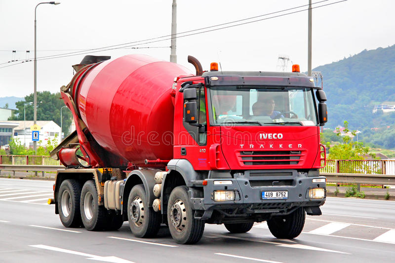 Iveco Trakker. USTI NAD LABEM, CZECH REPUBLIC - JULY 21, 2014: Red concrete mixer truck Iveco Trakker at the city street royalty free stock images
