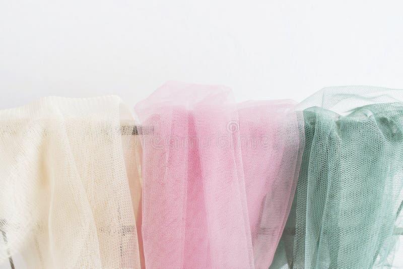 Ivoor, roze en groene Tulle stock afbeeldingen