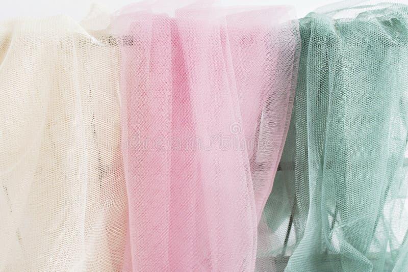 Ivoor, roze en groene Tulle stock afbeelding
