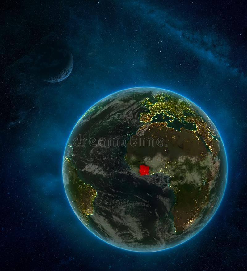Ivory Coast from space on Earth at night surrounded by space with Moon and Milky Way. Detailed planet with city lights and clouds. 3D illustration. Elements of stock illustration