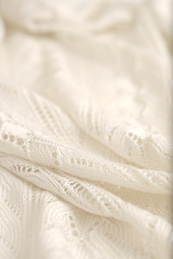 Ivory color crochet sweater. Texture detail close up with high key lighting. Ivory color crochet sweater. Texture detail close up. Studio shot royalty free stock photos