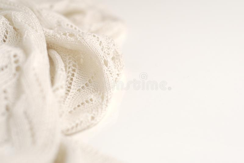 Ivory color crochet sweater on white background. Texture detail close up. Studio shot stock images