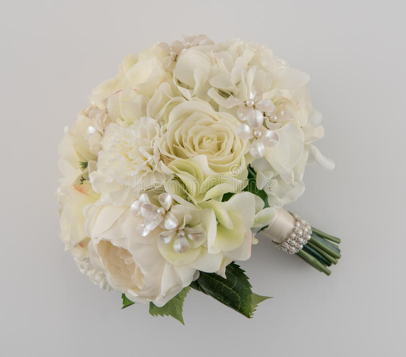 Ivory and Cream Brides Bouquet. Lavish ivory and cream bridal bouquet on white background stock photos