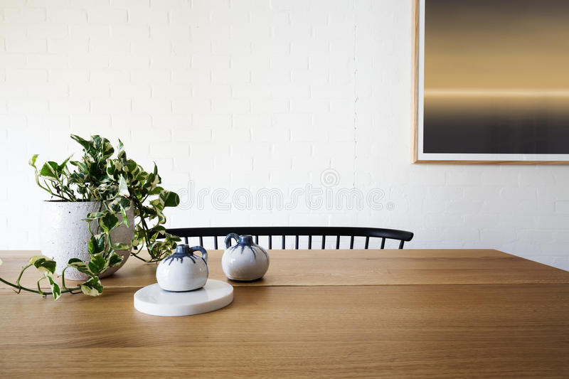 Ivy pot plant and white brick wall in dining room royalty free stock photo