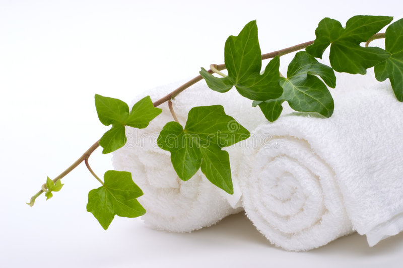 Ivy and towels royalty free stock images