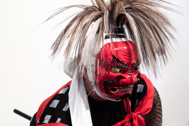 Iwasaki Onikenbai Dancer. With his full costume and mask stock image