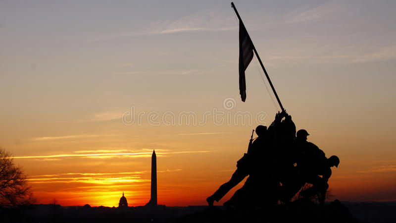 Iwo Jima Memorial - Dawn's Early Light. A view of the Iwo Jima Memorial in Arlington, Virginia as it overlooks the Washington Monument and U.S. Capitol in royalty free stock images