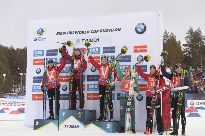 IX final stage of the Biathlon World Cup IBU BMW 2018. Tyumen. Russia. IX final stage of the Biathlon World Cup IBU BMW 2018 men`s race a massive start at 15 km stock photo