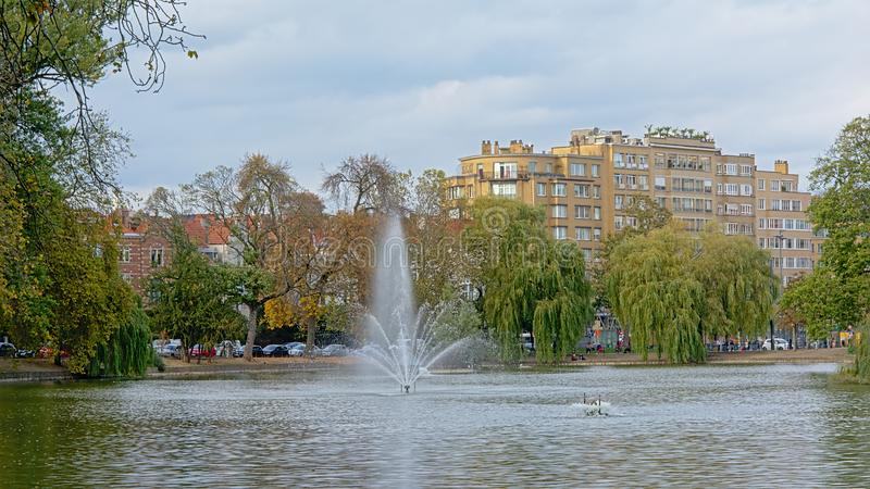 Ixelles lakes with fountain and willows royalty free stock photography