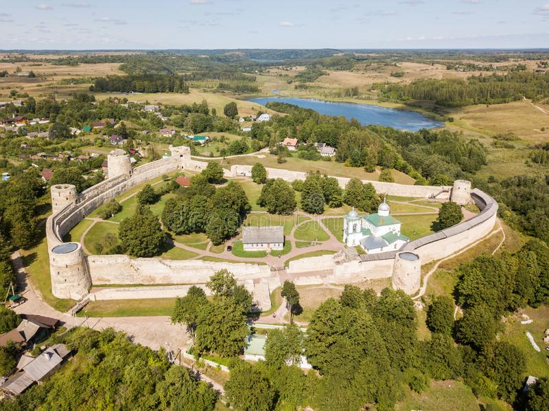 Izborsk medieval Russian fortress kremlin with a church. Aerial drone photo. Near Pskov, Russia. Birds eye view.  stock image